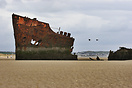 The wreck of a trawler on the beach at Clogherhead.
