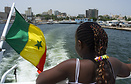 A girl in the back of the boat which links Dakar with the island of Go...
