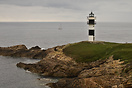 The old lighthouse of Ribadeo, now closed and replaced by a more moder...
