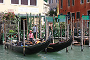 Gondolas moored alongside the Grand Canal in Venice