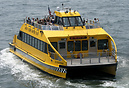 Ed Rogowsky, one of the large fleet of New York Water Taxi, approachin...