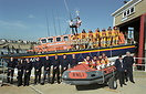 RLIB crew pose with their boat 'Hermione Lady Colwyn' outside the Shor...