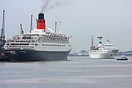 Two grand old ladies together, as Maxim Gorkiy passes QE2 whilst inbou...