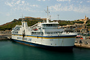 Gaudos takes on more passengers and vehicles at Mgarr on the island of...