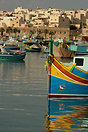 A traditional Maltese luzzu moored in Marsaxlokk harbour