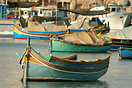 A traditional Maltese kajjik moored in Marsaxlokk harbour.