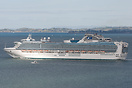 Spotlight on Diamond Princess as the sun comes out while rounding Nort...