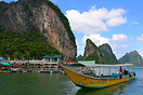 A large longtail pulling into the Muslim floating village Phang Nga Ba...