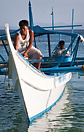 A water taxi in a traditional outrigger form approaches White Beach, P...