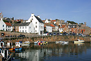 Fishing boats and yachts moored in Crail, a small fishing village loca...