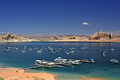 House boats and cabin cruisers on Lake Powell, Utah. Formed by the con...