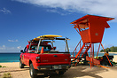 A lifeguard tower and beach patrol equipped with surfboards on Haena B...