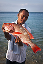 Fisherman in with an Ocean Perch (Redfish) White Beach, Philippines.