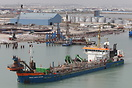 The dredger 'Dravo Costa Dorada' leaving the port of Tunis