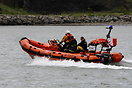 B class (Atlantic)rigid inflatable lifeboat 'Rockabill' provides cover...