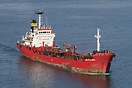 The bunkering vessel Santa Elena rides high in the water as it returns...