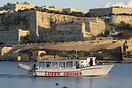The tour boat Antonia in Marsamxett harbour, beneath the multi-tiered ...