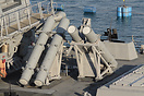 Harpoon anti-ship missile launch canisters on the rear deck of the des...