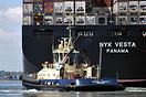 Tug Svitzer Ferriby assists the NYK Vesta at Southampton container ter...