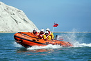 Eastbourne Inshore Lifeboat at sea waiting to escort the new all weath...