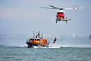 The Calshot Lifeboat on exercise with the coastguard helicopter off Ca...