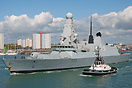 HMS Dauntless (D33), departing Portsmouth on the 6th May 2014, with tu...