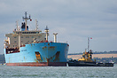 Maersk Rapier, which is on charter to the MOD, is seen being assisted ...