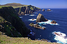 The dramatic cliffs and rock stacks at the north end of Fair Isle, She...